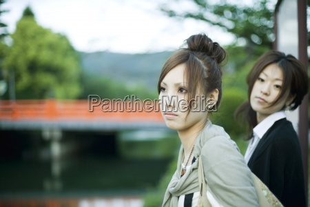 young females outdoors looking away bridge
