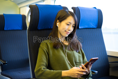 woman sitting in train compartment and