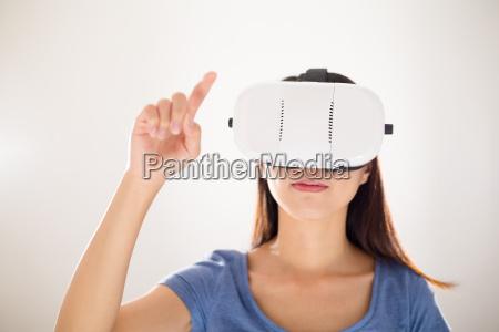 asian woman virtual reality device