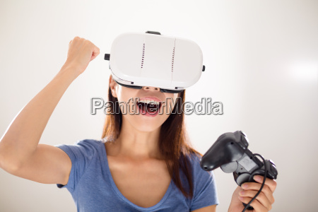 woman play video game with virtual