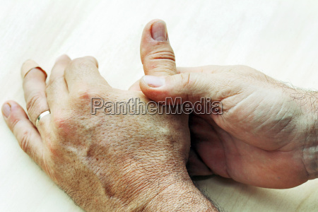 an elderly man has pain in