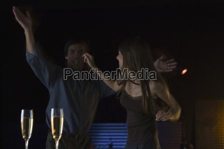 couple dancing in nightclub glasses of