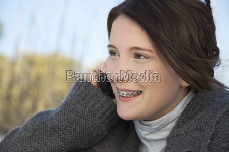 teen girl talking on cell phone