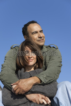 mature couple relaxing together outdoors
