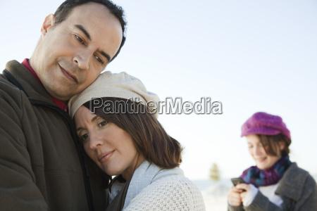 mature couple embracing outdoors