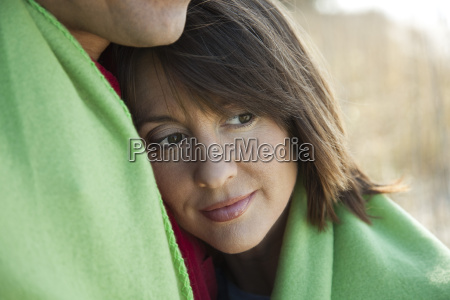 woman resting head on husbands chest