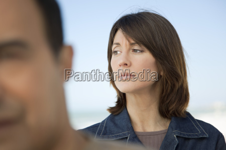 woman looking away with furrowed brow