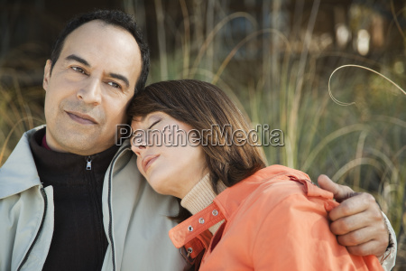 mature couple relaxing together outdoors portrait