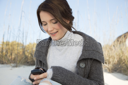 teen girl text messaging at the