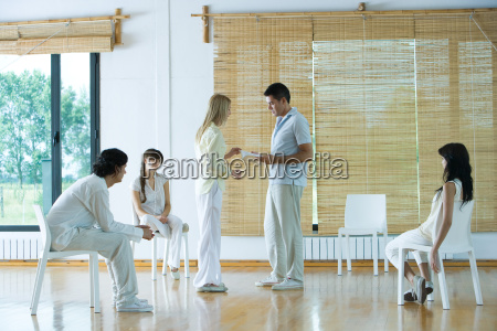 group therapy adults sitting in circle