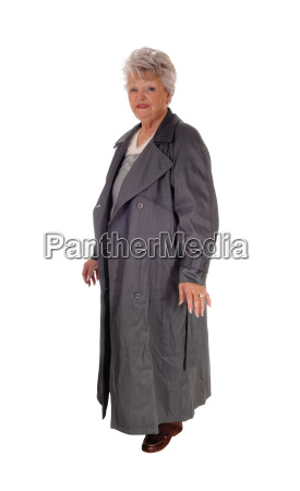 senior woman standing in a long