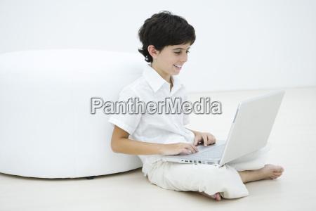 boy sitting cross legged on the
