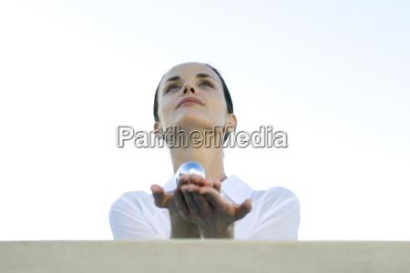 woman holding yin yang balls in
