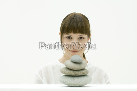 woman with stack of stones portrait