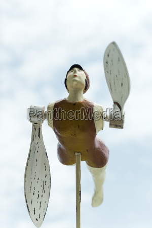 wooden whirligig carved in the shape