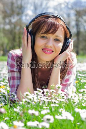 woman listening music outdoor