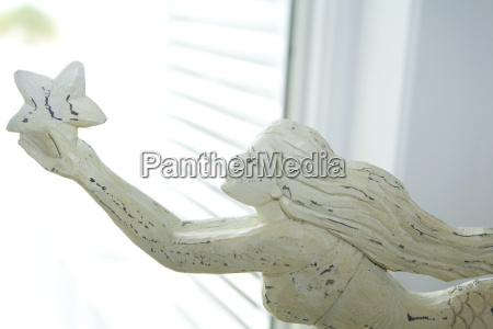 wooden carving of mermaid cropped