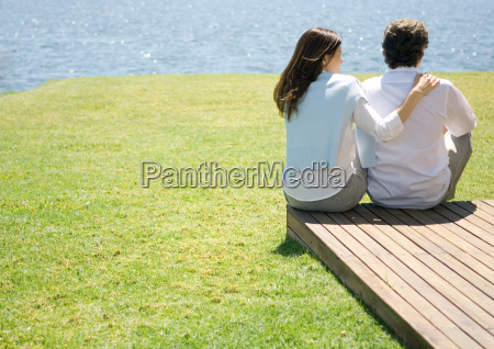 mature couple sitting at end of