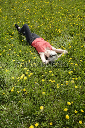 woman relaxed on meadow