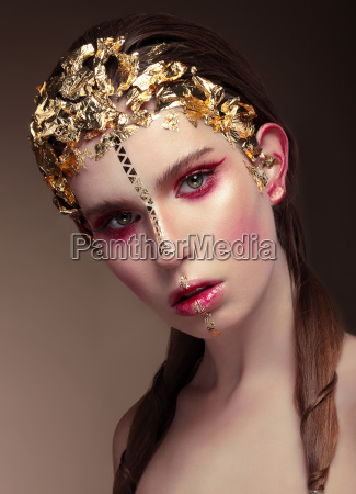 woman with gold face make up