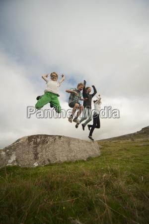 united kingdom england cornwall children jumping