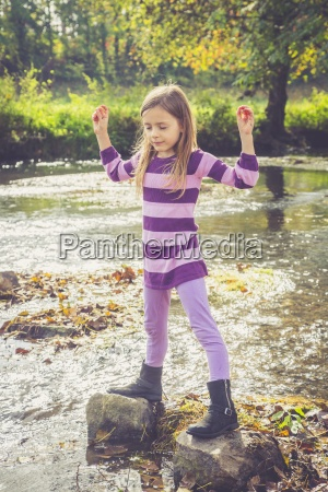 little girl doing relaxation exercise at