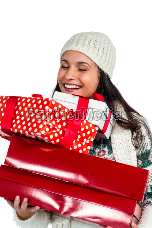 smiling woman holding red and white