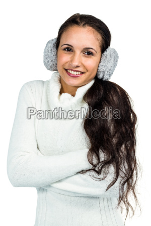 smiling woman with earmuffs crossing arms