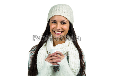 smiling woman holding white cup