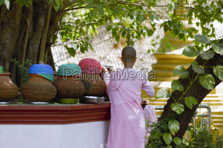 burmese girl monk getting fresh water