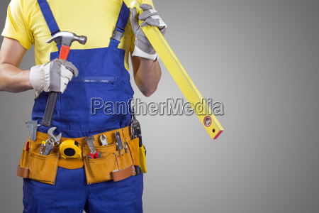 construction worker with tool belt on