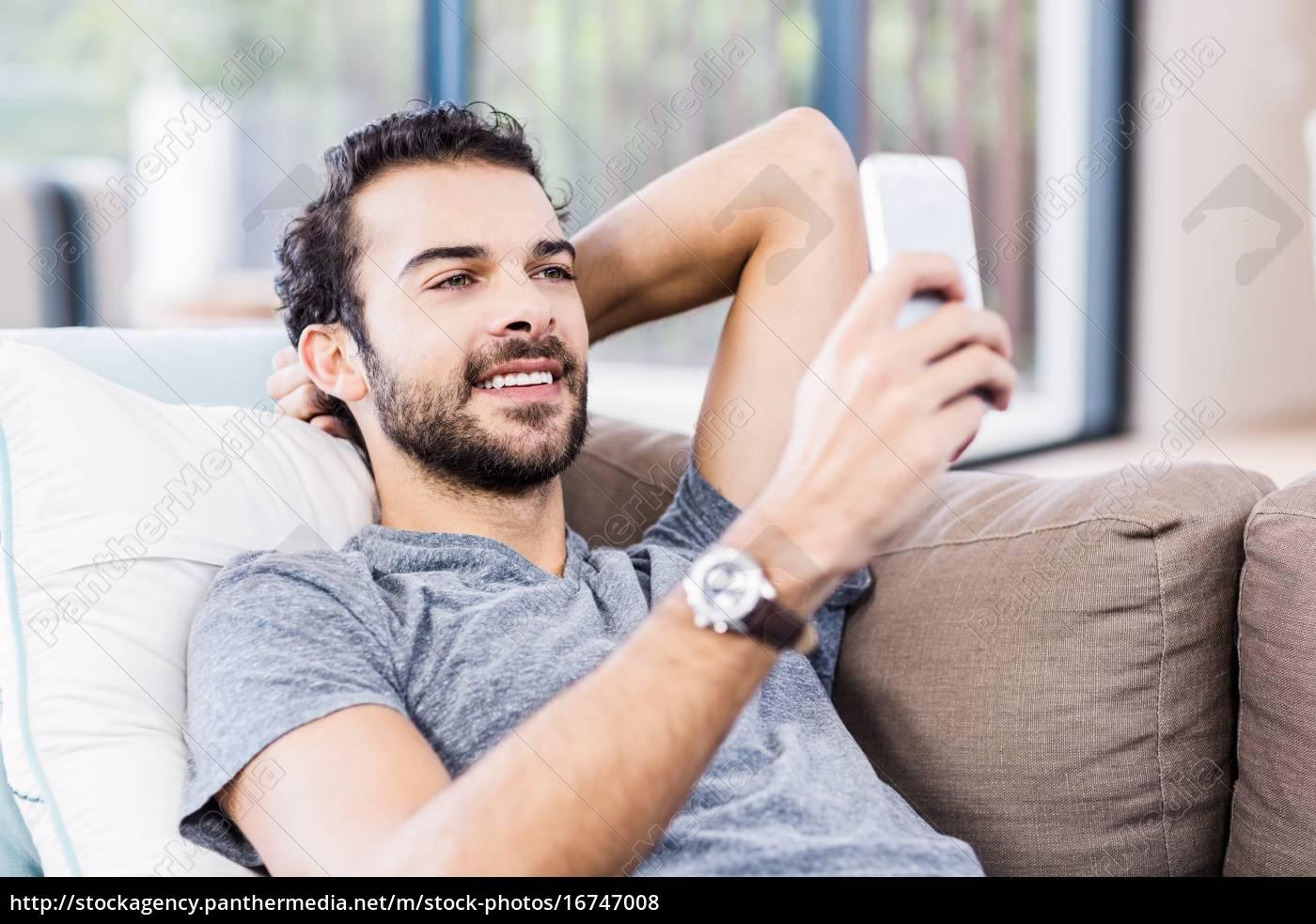 handsome, man, using, smartphone - 16747008