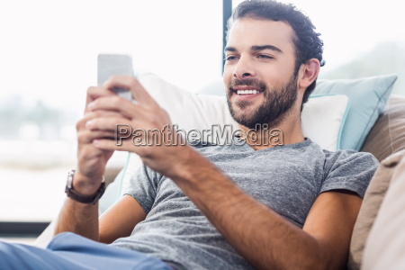 handsome man using smartphone