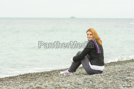 smiling young girl sitting on a