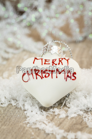 white heart shaped christmas bauble with