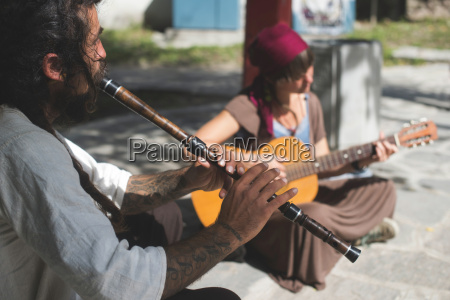 bulgaria plovdiv street musician playing flute