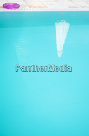 reflection of a parasol in a