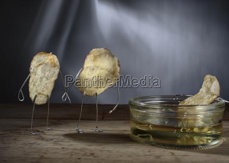 potato chip manikins calling on chip