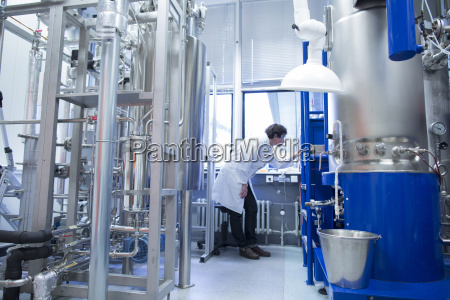 woman with lab coat in technical