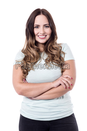 happy young woman with folded arms