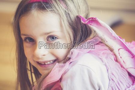 portrait of smiling little girl masquerade