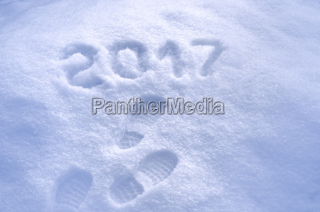 new year 2017 greeting footprints in