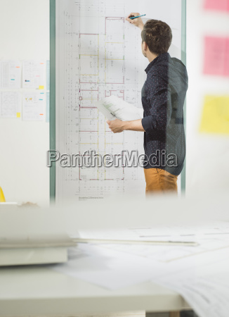 young architect in office working at