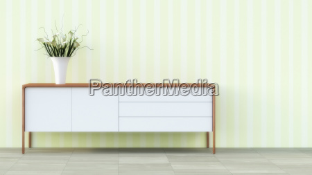 sideboard with flower vase in front
