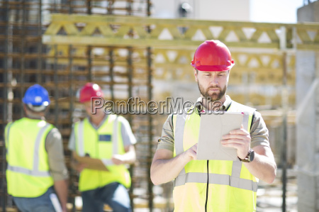 construction worker using digital tablet in