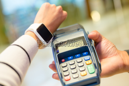woman using wearable smartwatch for paying