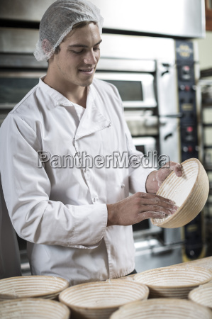 baker preparing ceramic bowls for baking