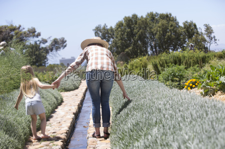 woman and little daughter walking in