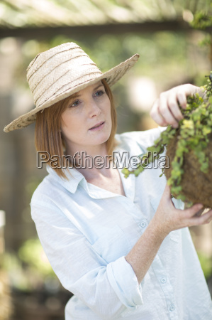 portrait of female gardener with plant