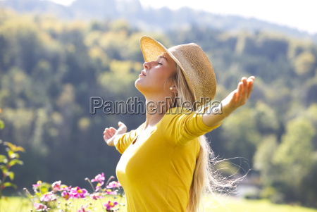 relaxed teenage girl with outstretched arms